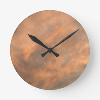 Sunset through clouds. round clock