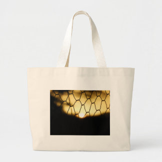 Sunset through the fence large tote bag
