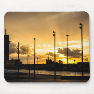 Sunset with rays of light filtering through clouds mouse pad