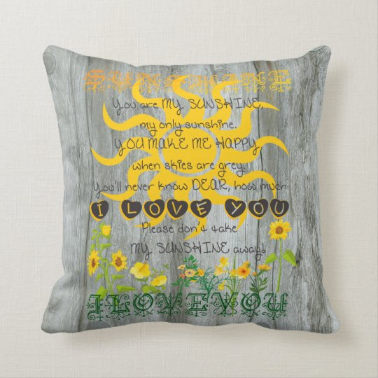 Sunshine Pillow with Driftwood Background
