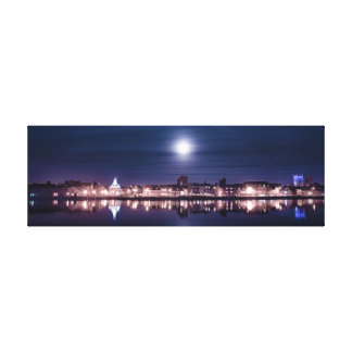 Super moon rising over Kings Lynn's night harbor Canvas Print
