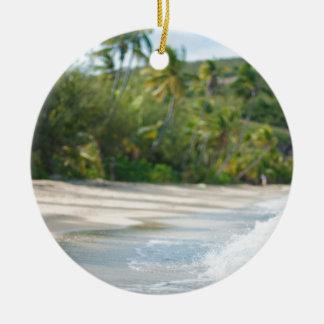 Surf breaking on a sandy beach round ceramic ornament