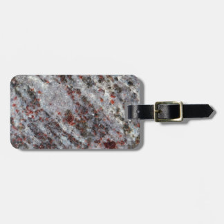 Surface of a gneiss rock with garnets luggage tag