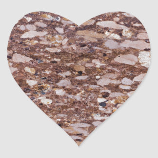 Surface of a red sandstone with siliceous geods heart sticker