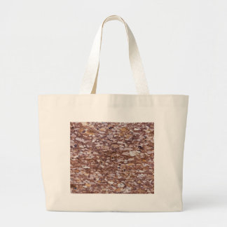 Surface of a red sandstone with siliceous geods large tote bag