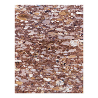 Surface of a red sandstone with siliceous geods letterhead