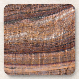 Surface of carbonate rock with weathering traces drink coaster