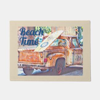Surfboard on back of old Truck Doormat