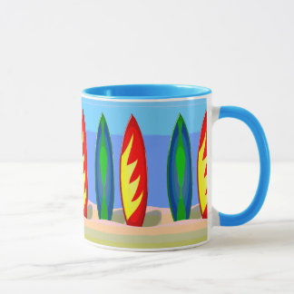Surfboards in the sand mug