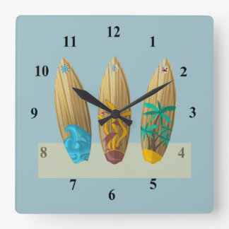 Surfboards on the sand square wall clock