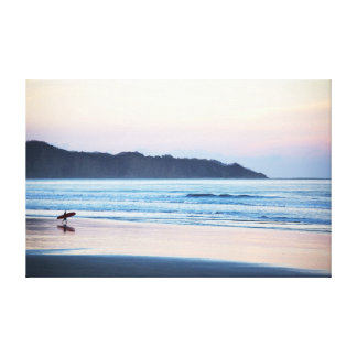 Surfer off to catch the last waves in Costa Rica Canvas Print