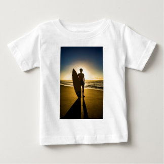 Surfer silhouette during sunrise baby T-Shirt