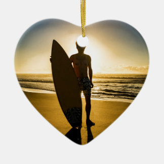 Surfer silhouette during sunrise ceramic ornament