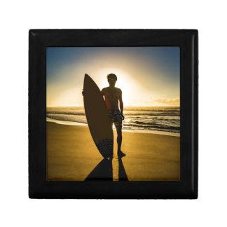 Surfer silhouette during sunrise gift boxes