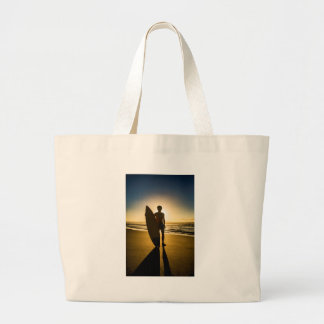 Surfer silhouette during sunrise large tote bag