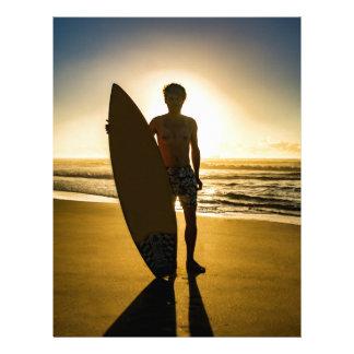 Surfer silhouette during sunrise letterhead
