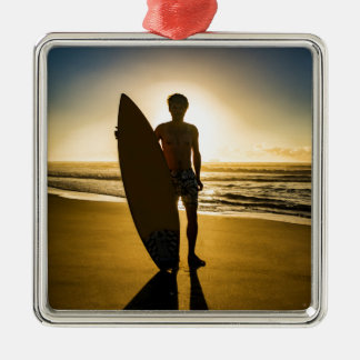 Surfer silhouette during sunrise metal ornament