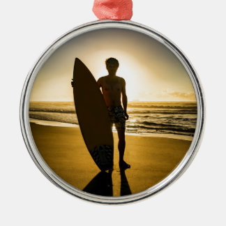 Surfer silhouette during sunrise metal ornament