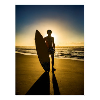 Surfer silhouette during sunrise postcard