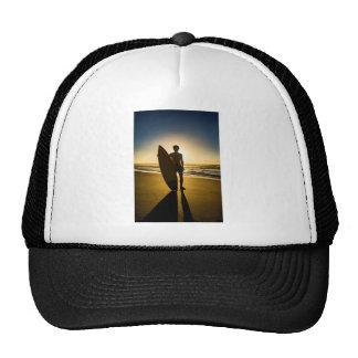 Surfer silhouette during sunrise trucker hat