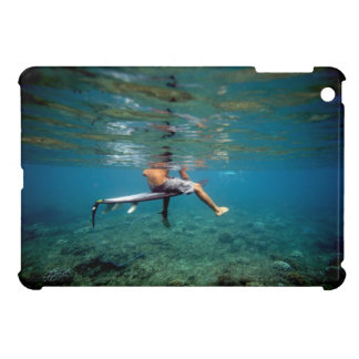 Surfer sitting on surfboard underwater green reef cover for the iPad mini
