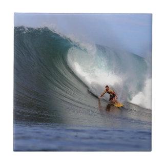 Surfer surfing huge tropical island surfing wave tile