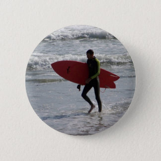 Surfer with surf board with waves 2 inch round button