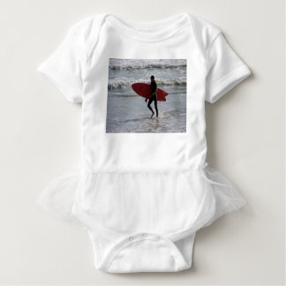 Surfer with surf board with waves baby bodysuit