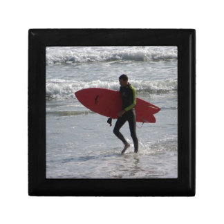 Surfer with surf board with waves gift box