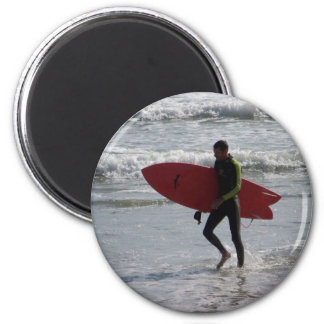 Surfer with surf board with waves magnet