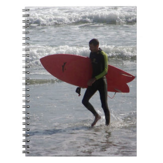 Surfer with surf board with waves notebook