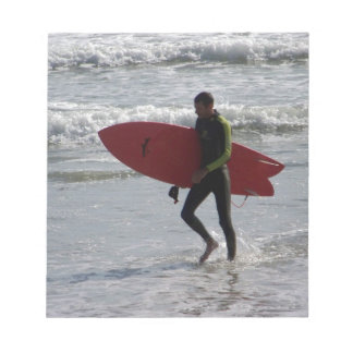 Surfer with surf board with waves notepad