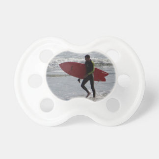 Surfer with surf board with waves pacifier
