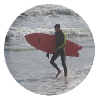 Surfer with surf board with waves plate