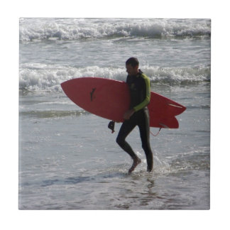 Surfer with surf board with waves tile