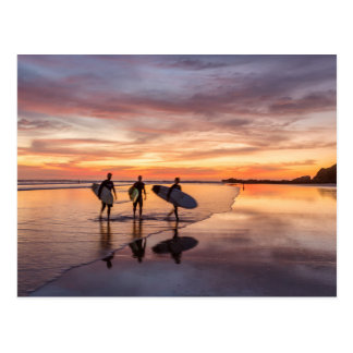 Surfers At Sunset Walking On Beach, Costa Rica Postcard