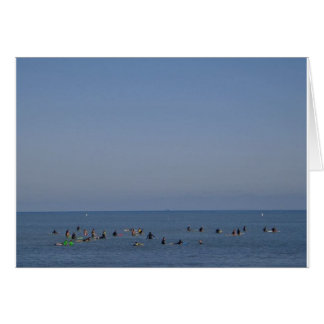 surfers waiting a wave card