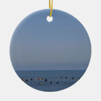 surfers waiting a wave ceramic ornament