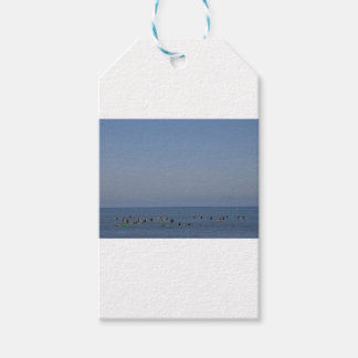 surfers waiting a wave gift tags