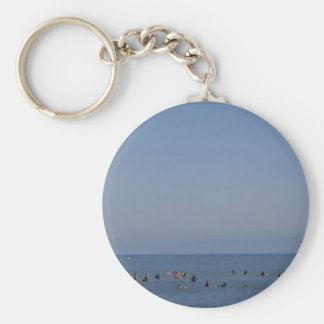 surfers waiting a wave keychain