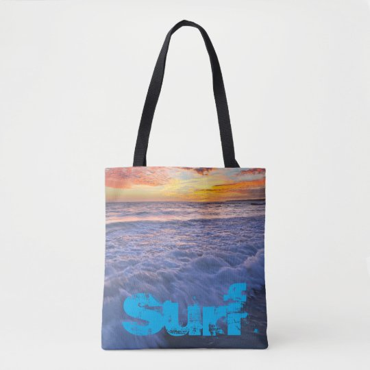 Surfing beach waves at sunset tote bag