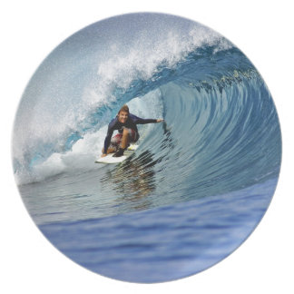 Surfing blue wave tropical island reef plate