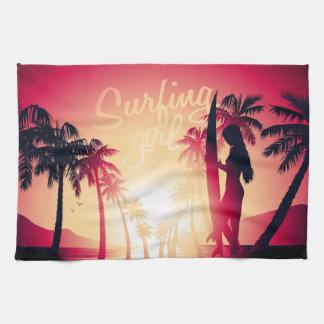 Surfing girl at sunrise kitchen towel