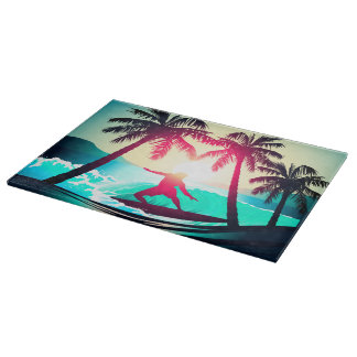 Surfing with palm trees cutting board