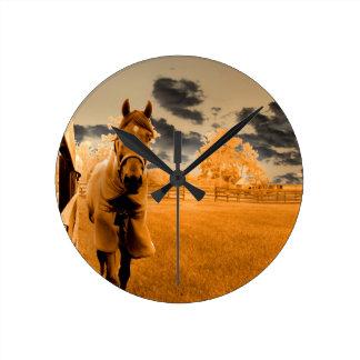 surreal horse walking down fence orange sky clocks