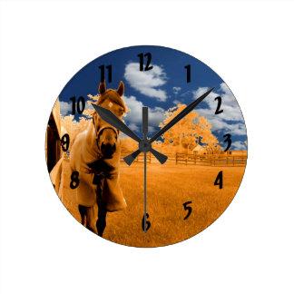 surreal horse walking fence orange blue sky clocks
