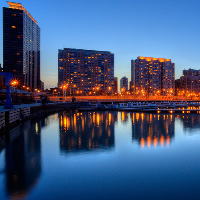 High rises along lake with reflection from