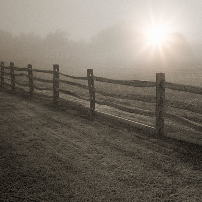Fence and Sunburst Through Fog near Sharon