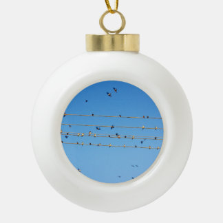 Swallows on wire ceramic ball ornament
