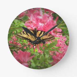 Swallowtail Butterfly Sits on Pink Azaleas Round Clock